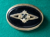 Silver brooch with crystal, gold plated