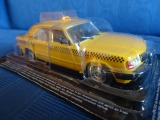 Machine Volga taxi GAZ-3110 in the package