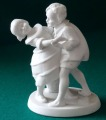 Dancing children. Biscuit, h 12 cm, with a crack