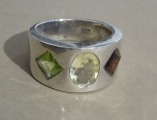 Silver ring with precious stones