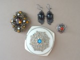 Powder box, brooch, sakta and earrings