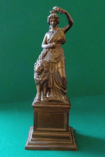 Cast iron figure with lion, h 22,5 cm